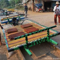 """The Bamboo """"train"""", which, it is not such thing,  is only a platform resting over to axes with four wheels connected by a string to a grass cutter engine. Riding this """"train"""" is very nice, funny and noisy."""