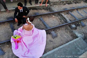 At the end of the first way we met a wedding; the bride and the groom, both absolutely dressed up, shared loving looks over the bamboo platform that was decorated with cheering white balloons. Even they had to give way to other trains.